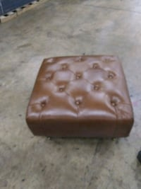 Two Leather Ottamans