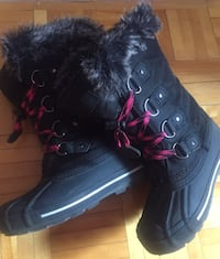 pair of black leather boots Montreal