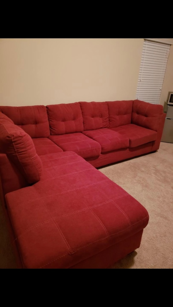 red fabric sectional sofa with ottoman