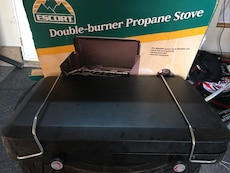 black Escort double-burner propane stove