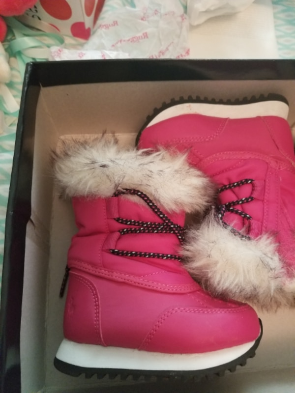 pair of red fur-lined boots