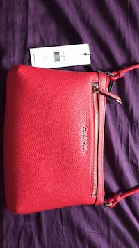 Red leather Calvin Klein  wristlet