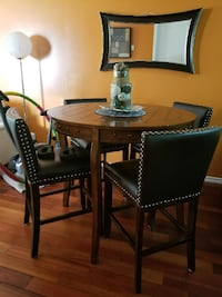 round brown wooden table with four chairs dining set EDMONTON