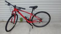 red and black hardtail mountain bike 665 mi