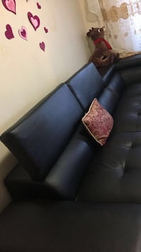 Black leather sectional sofa with throw pillows Surrey, V4N 1J8