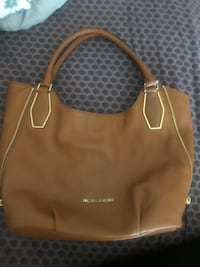 Michael Kors purse price is firm