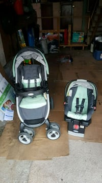 baby's black and green travel system Port Moody, V3H 0B5