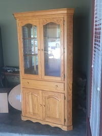 Oak corner china cabinet.  It has a recessed light overhead to display China