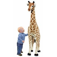brown giraffe plush toy; baby's blue crew neck long sleeves shirt