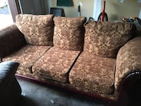 Brown 3-seat couch with floral pattern