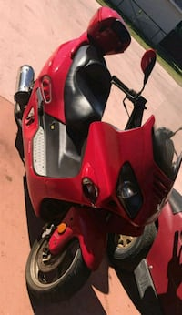 red and black motor scooter 1483 mi