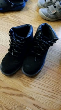 pair of black high-top sneakers Calgary, T3A 6A8