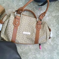 brown and beige leather tote bag