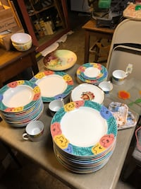 We got nice colorful dish set lots of plates and other items   Looks like set of 12 plates. And other matching plates Lowell, 01852