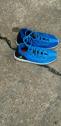 pair of blue-and-white Nike running shoes West Memphis, 72301