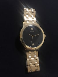 Brand new Gold analog guess watch