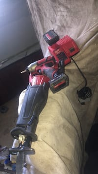 Red and black milwaukee cordless power drill and saws all Surrey