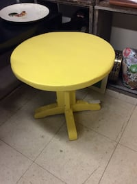 round yellow and blue wooden table