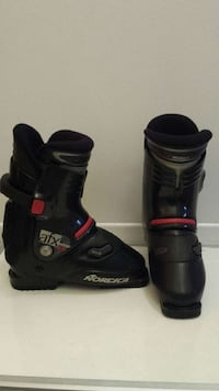 pair of black-and-red Norcica snowboard boots