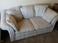 grey and white loveseat