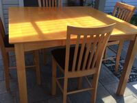 Rectangular brown wooden table with four chairs dining set St Catharines, L2M 3B7