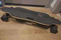 WOWGO ELECTRIC LONG BOARD w/ dual hub motors + charger & remote