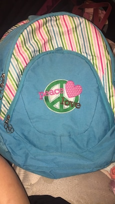 teal, green, and white Peace backpack