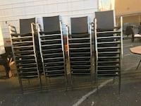 10 Black vinyl and metal stacking chairs Germantown