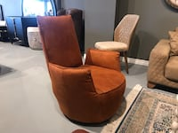 brown suede sofa chair with throw pillow THORNHILL