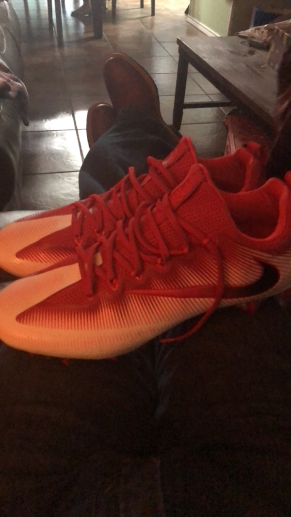 pair of red Nike cleats