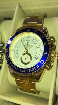round blue and gold Invicta chronograph watch with link bracelet 551 km