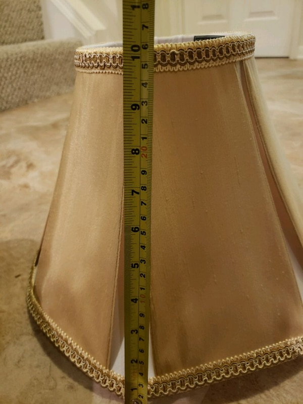 two brown-and-white lamp shades e4d05f33-6807-4261-9fe3-4aa0961812cf