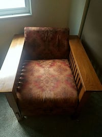brown wooden frame with red floral padded armchair Colorado Springs, 80909