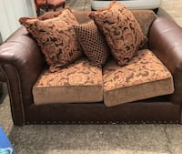 brown and black floral loveseat Douglasville, 30134