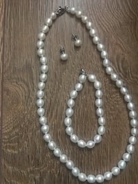 Real freshwater pearl necklace earring and bracelet set.