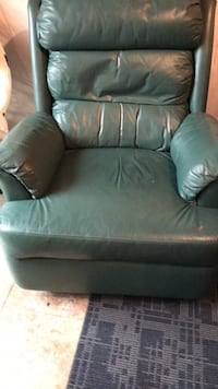 2 green leather recliner 50 each 25 km