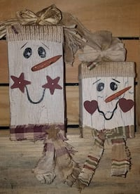 two wooden post snowman