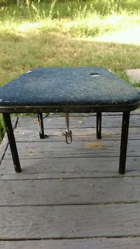 rectangular black wooden table with two chairs