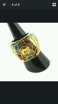 gold and green gemstone ring