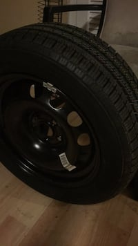 black 5-spoke vehicle wheel and tire Virginia Beach, 23452
