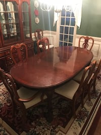 Solid cherry wood dining table 8 chairs and China cabinet