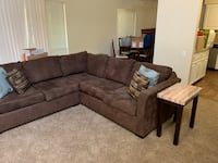 Brown sectional Gomen couch with 2 marble top end tables Sacramento, 95832