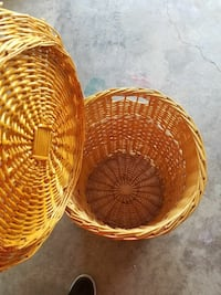 cylindrical wicker brown clothes hamper
