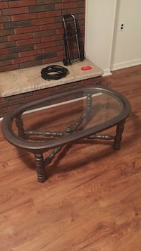 Round brown wooden framed glass top coffee table Knoxville, 37920