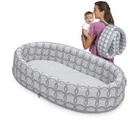 baby's gray and white travelling bed