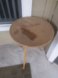 Round decorative table. Stained but sturdy.