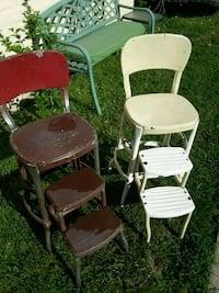 two white metal framed chairs
