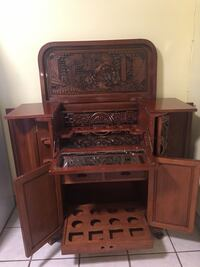 Antique carved liquor cabinet Burnaby, V5A 2R3