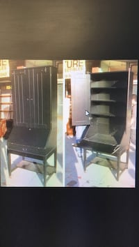 Black wooden slant-top desk with hutch