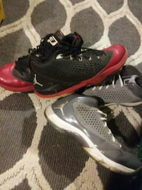 two pairs of black-and-red and gray Air Jordan basketball shoes